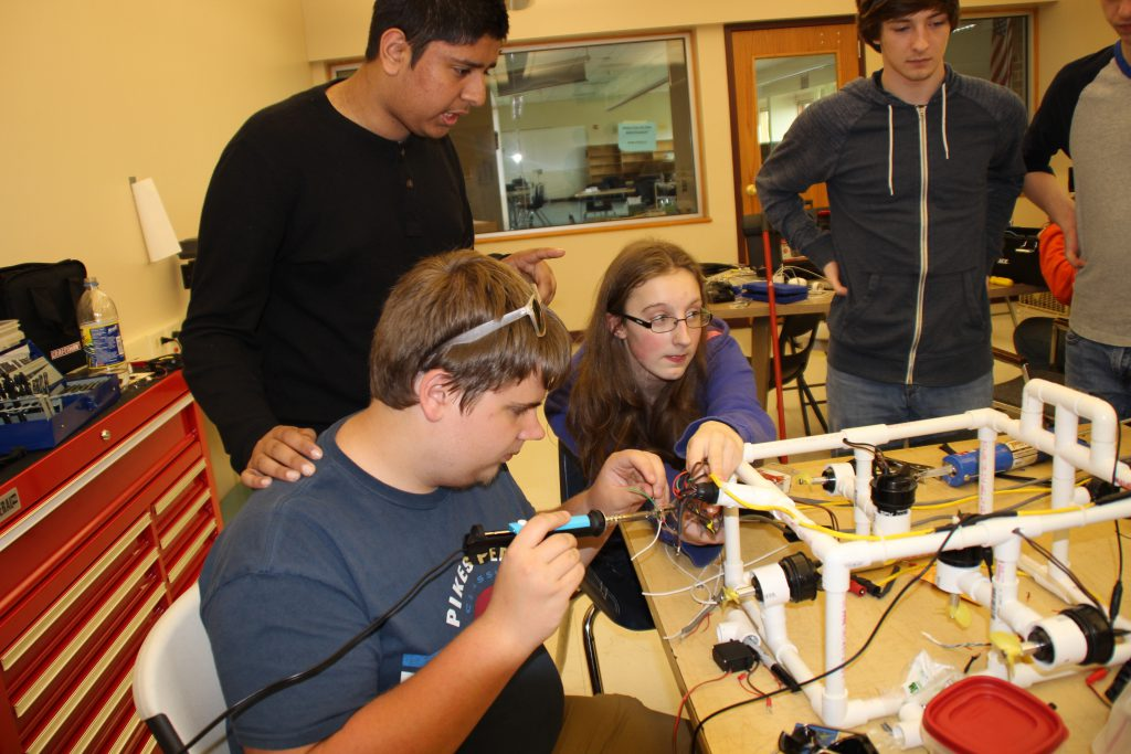 PTECH students working on an underwater robot