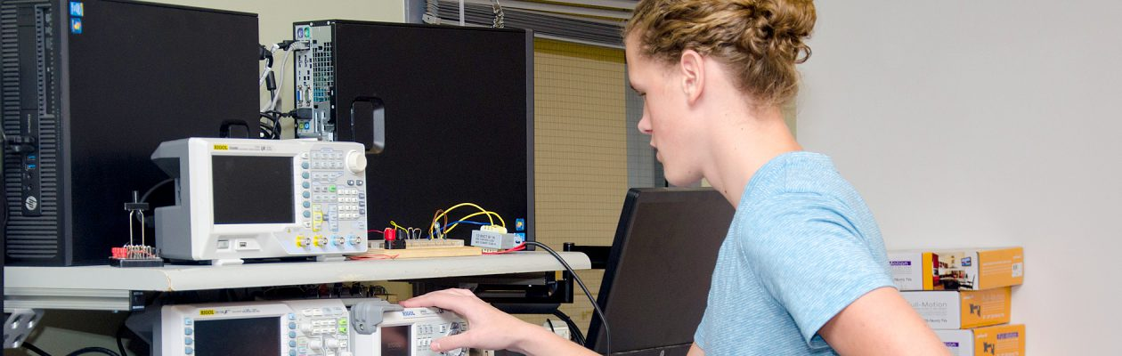 CTE network technician student works with monitoring devices
