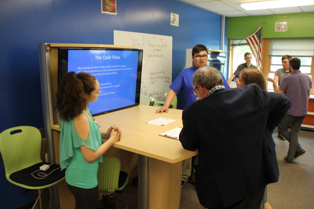 A student speaks to a business professional about his business concept