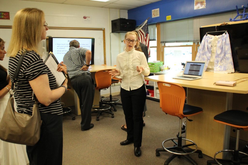 A student speaks to a business professional about her business concept