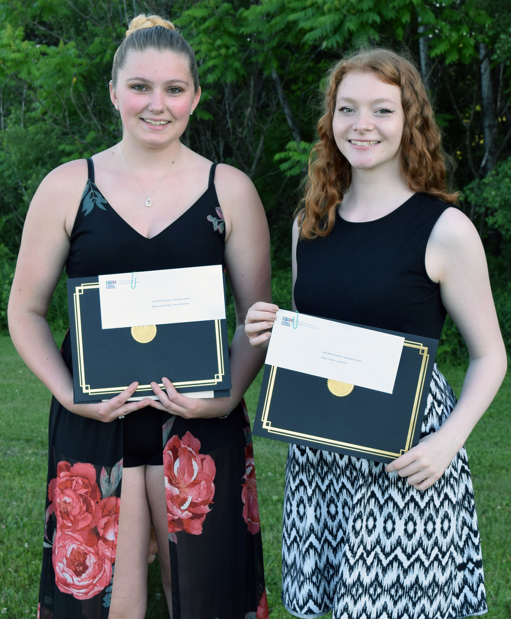 Bladek and Tesiero hold their certificates posing for a picure.