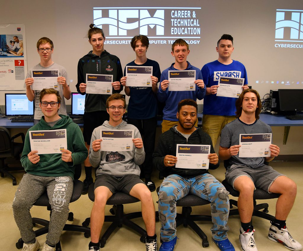 Nine Cybersecurity students pose with their certificates