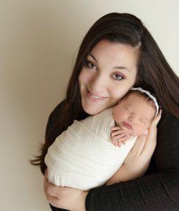 Cassandra Hehl holding a tiny infant